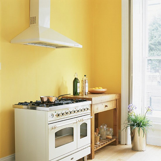 Kitchen Wall Paint Color Ideas: Yellow Kitchen With Range Cooker And Butcher's Table