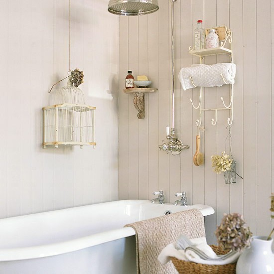 Small Bathroom With Freestanding Bath Shower And Wire
