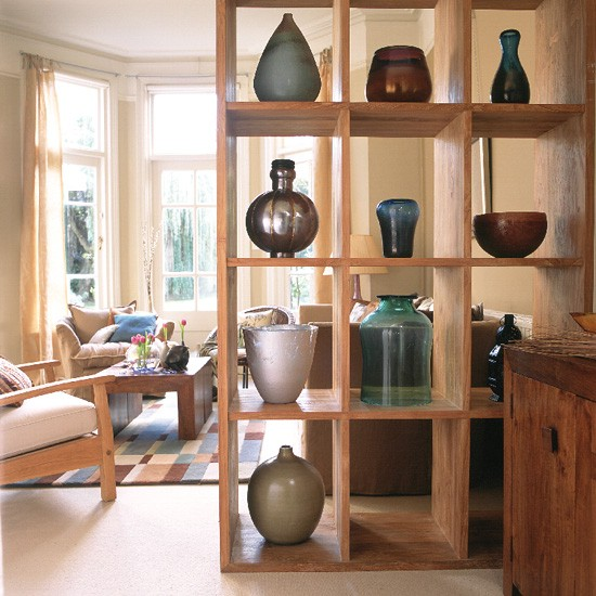 Modern Country Living Room: Neutral Room With Wooden Unit Displaying Vases