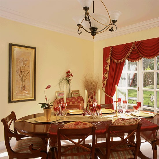 traditional dining room with ornate red curtains. Black Bedroom Furniture Sets. Home Design Ideas