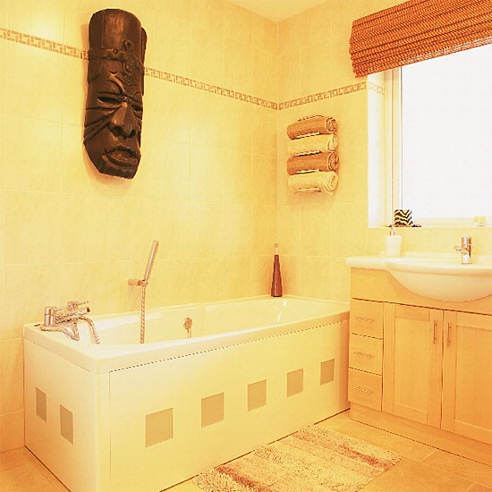 Bathroom Walls Sweating Yellow: Yellow Bathroom With White Suite And African Mask
