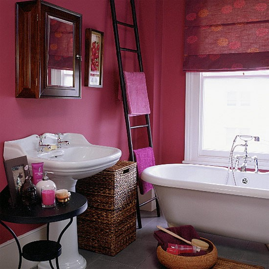 Bathroom With Pink Walls Blind And White Suite