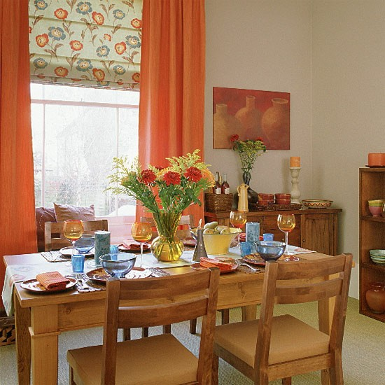 Dining Room Orange: Dining Room With Wooden Furniture, Floral Blind And Orange