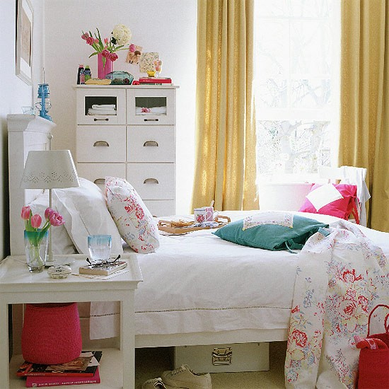 Bedroom With White Painted Furniture And Floral Quilt