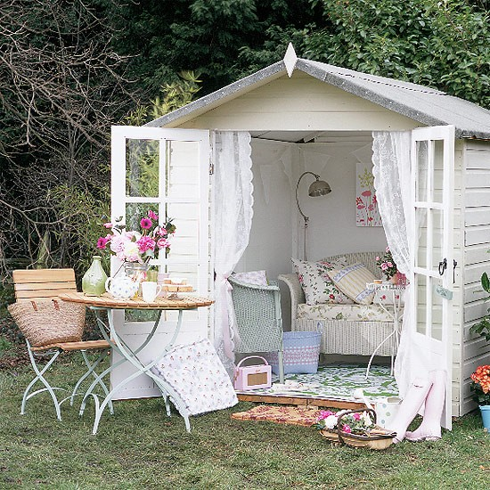 small white shed with open doors and shabby chic style decorations