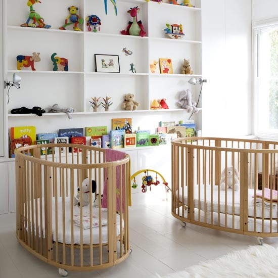 wooden cots for twins dominate this playful children's nursery ...