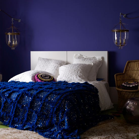 Luxurious Bedroom With Deep Blue Walls And White Bed