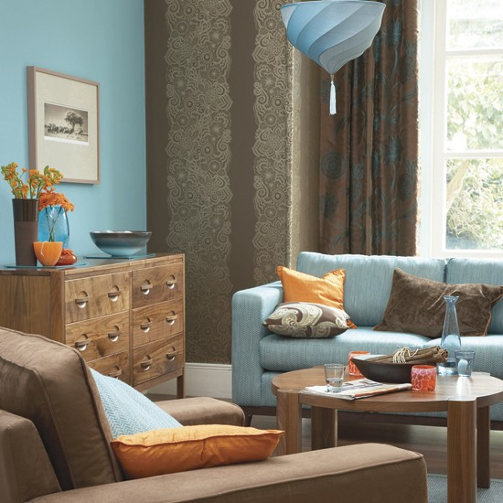 Bold blue and orange living room decorating with contrasting colours - Brown and orange living room ...