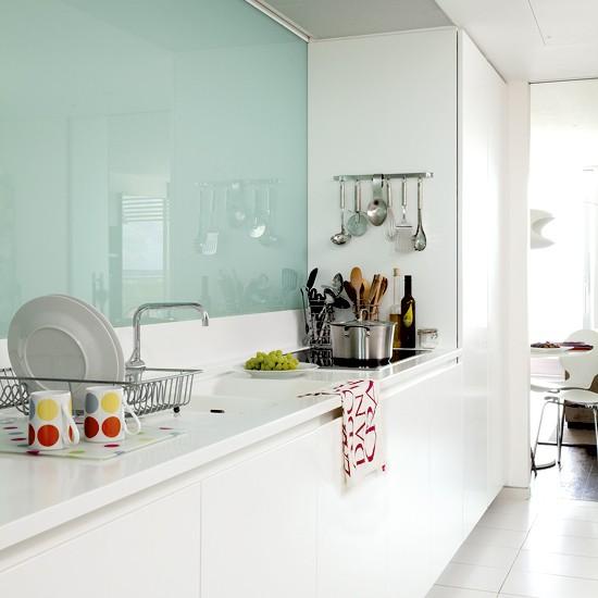 narrow white kitchen  small kitchen design  housetohome