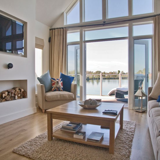 spacious coastal style living room coastal interiors for living rooms. Black Bedroom Furniture Sets. Home Design Ideas
