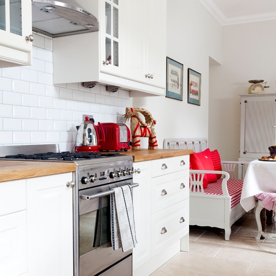 Modern White Kitchen With Red Accessories Housetohome Co Uk