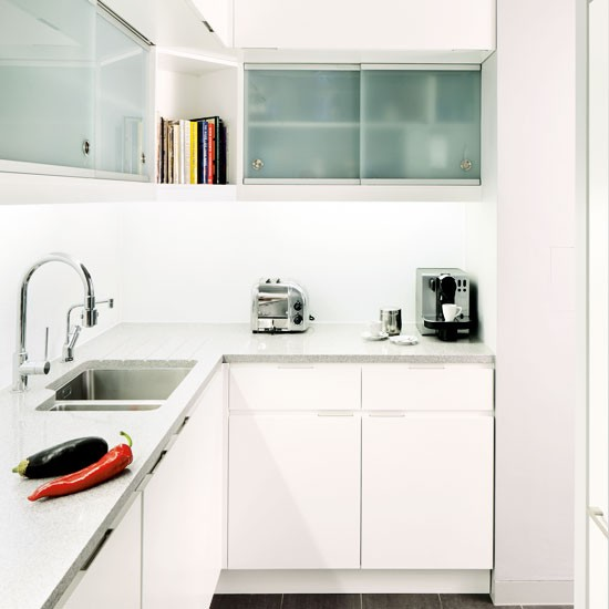 All-white L-shaped Fitted Kitchen