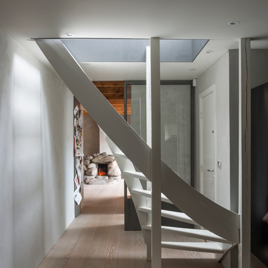 White Hallway With Curved Staircase