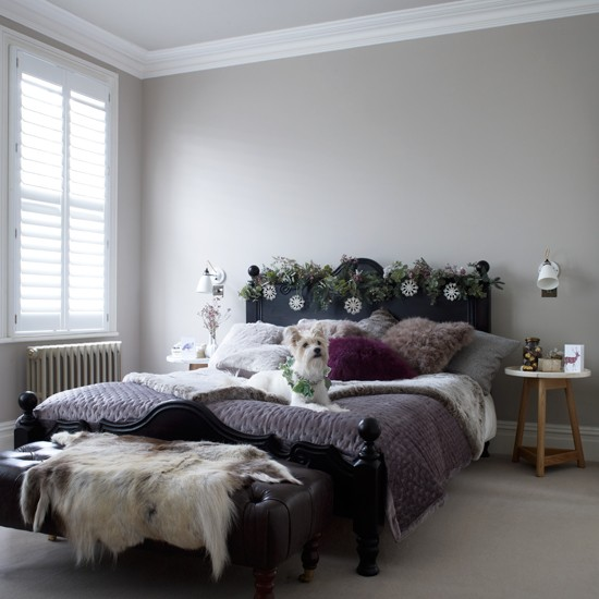 Neutral Bedroom With Purple Throw