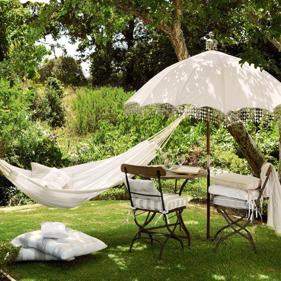 Garden Retreat With Hammock And Parasol