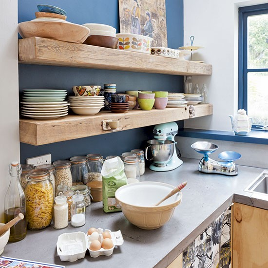 Timber shelves on bold painted wall | Kitchen shelving ...