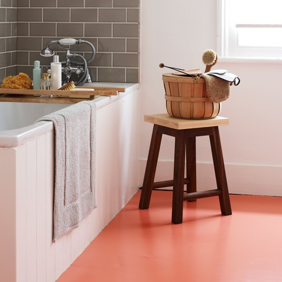 White Bathroom With Orange Vinyl Flooring