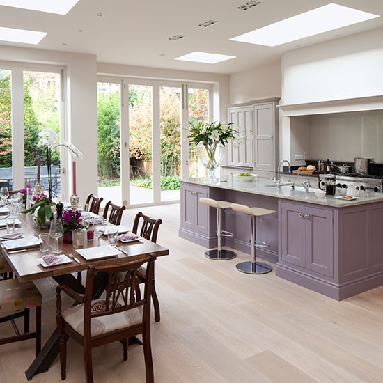 Spacious grey and purple kitchen diner with oak wood floor ...