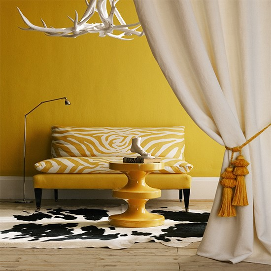 yellow living room with zebra print sofa  tribal room