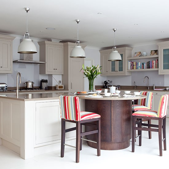 Pale Grey Kitchen With Shaker Cabinets And Curved Island