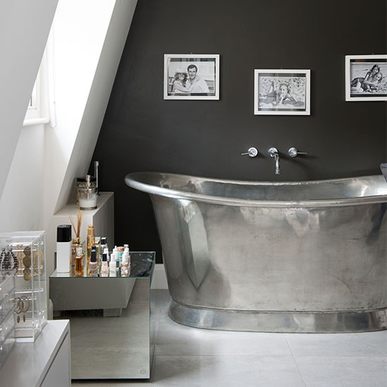 Streamlined Attic Bathroom With Silver Roll Top Bath
