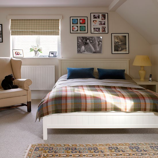 Traditional White Bedroom With Tartan Throw
