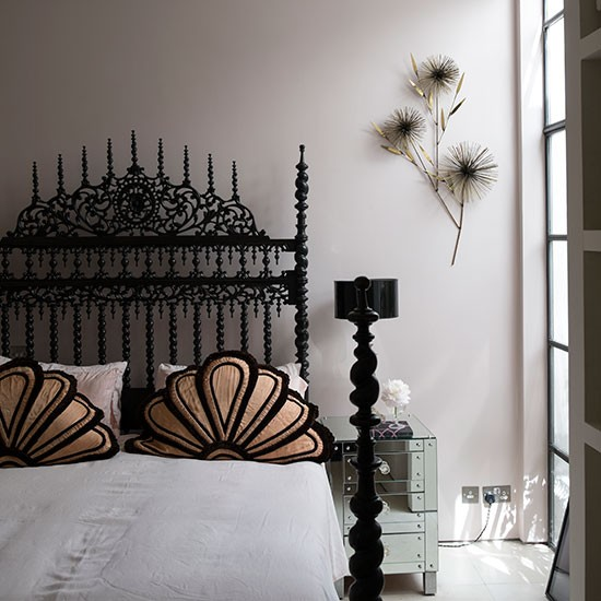 White Bedroom With Black Ornate Bed