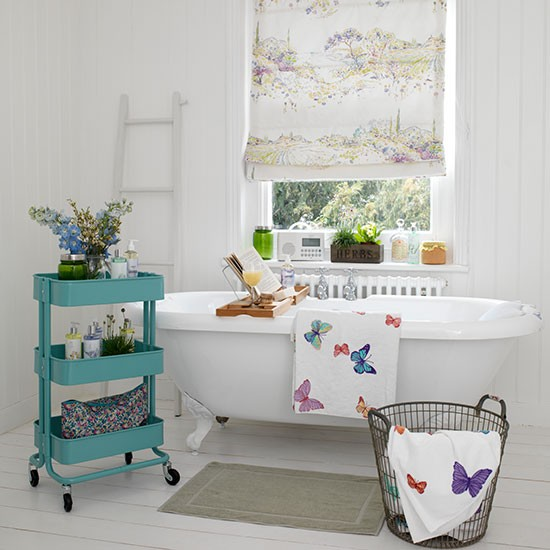 White Bathroom With Cladding And Butterfly Towels