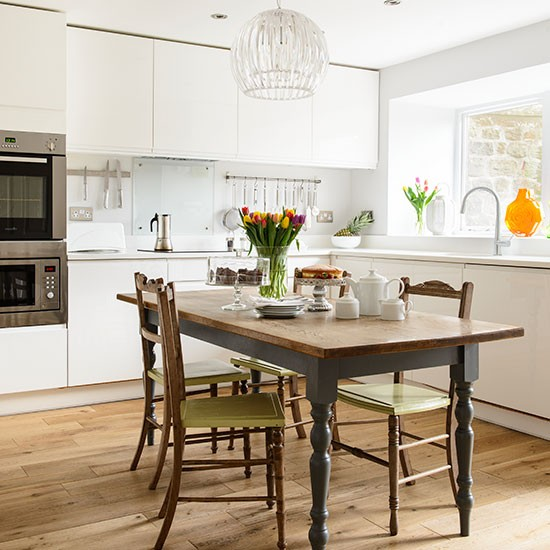 White Gloss Kitchen With Wooden Table