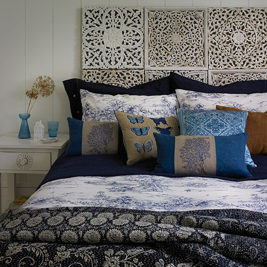 Bedroom With Carved Wooden Headboard