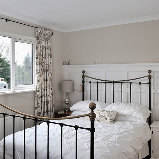 Neutral bedroom with floral curtains | Traditional bedroom ...