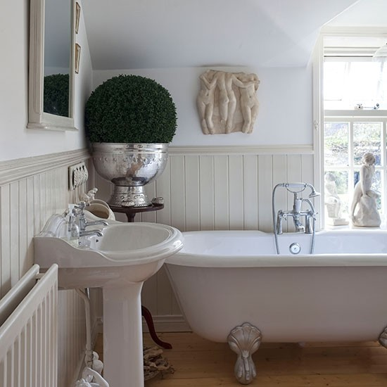 Cream Panelled Bathroom With Roll-top Bath