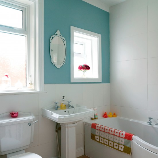 Compact Bathroom With Colourful Feature Wall