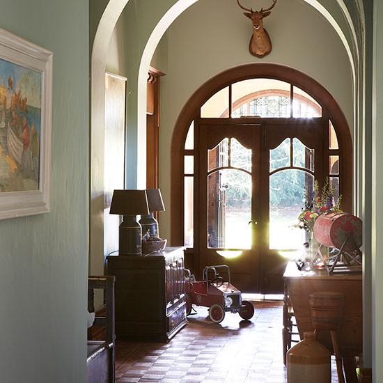 Green Hallway Victorian: Arched Sage Green Hallway