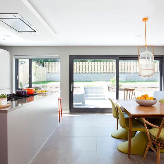 Burford Place Open Plan Kitchen With Breakfast Bar Island: Modern Open-plan Kitchen With Orange Accents