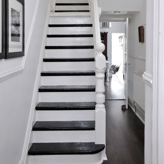 White Hallway Staircase With Treads Painted Black