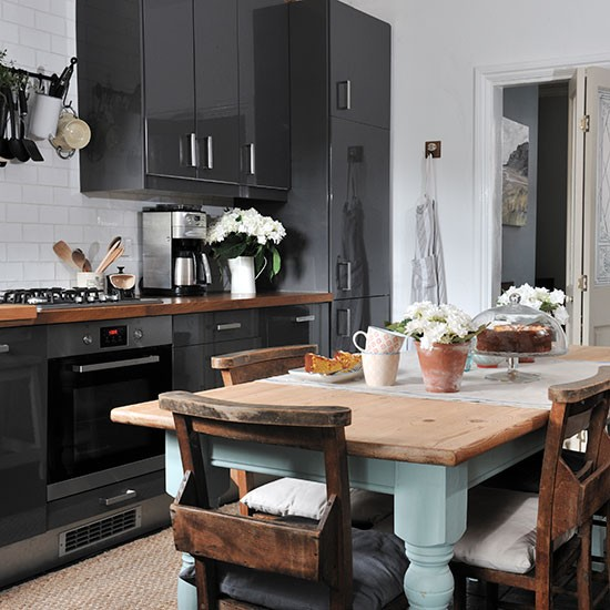 Grey Gloss Kitchen With Rustic Table Decorating