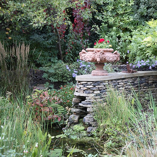 Country Garden With Dry Stone Wall Feature