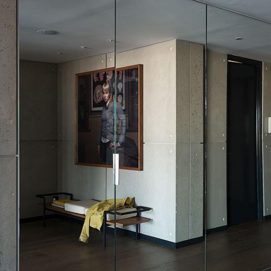 Hallway With Mirrored Storage Doors
