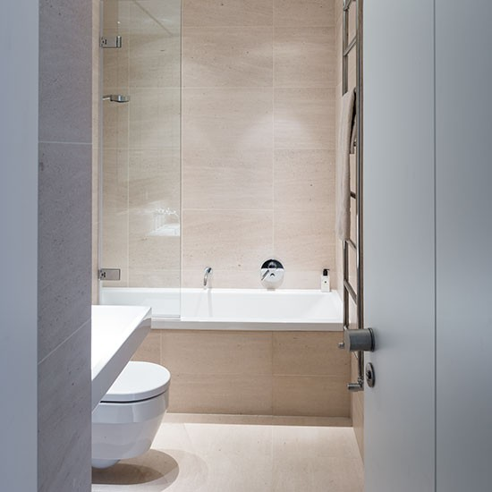 neutral bathroom with largeformat tiles  decorating