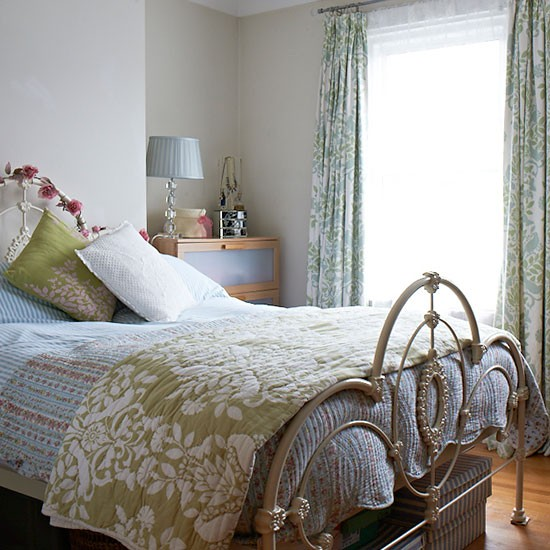 Feminine Bedroom With Floral And Striped Accessories
