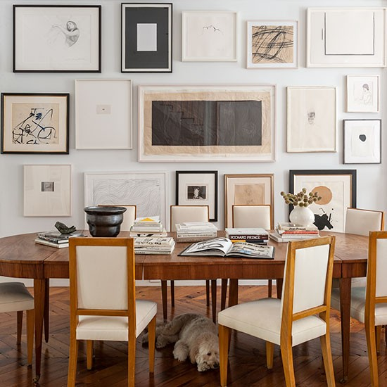 Neutral Dining Room With Framed Artwork