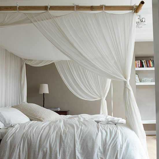 Neutral Bedroom With White Curtains Around Bed Neutral