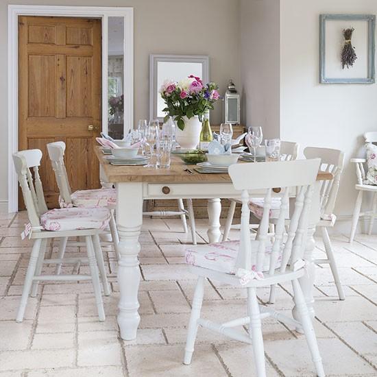 White Farmhouse Kitchen With Lavender Artwork
