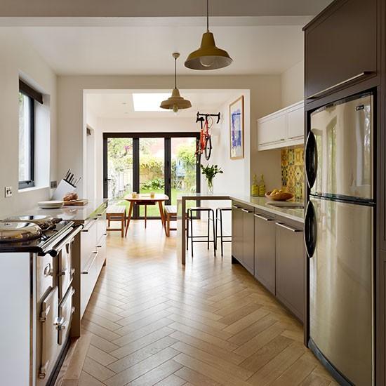 Galley Kitchen With Parquet Flooring