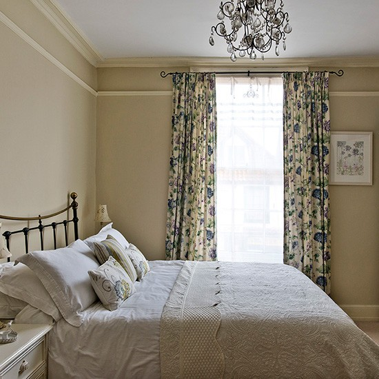Neutral Country Bedroom With Blue Floral Curtains