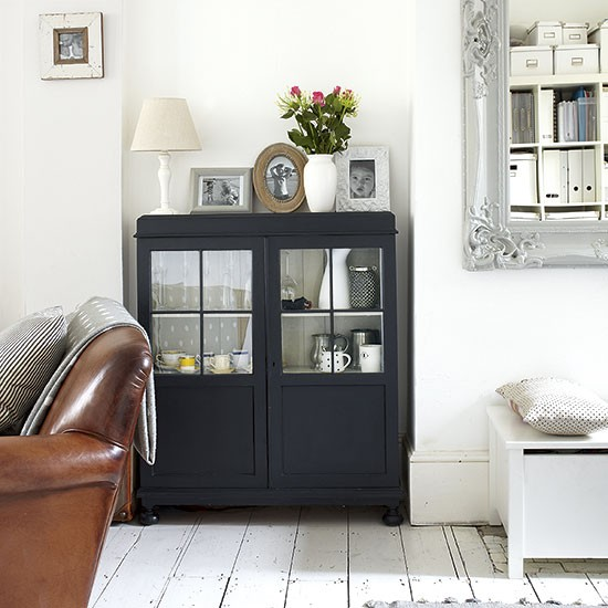 White Living Room With Black Cabinet