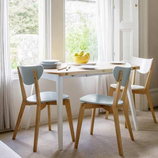 White Dining Room With Half Moon Table And Pastel Chairs