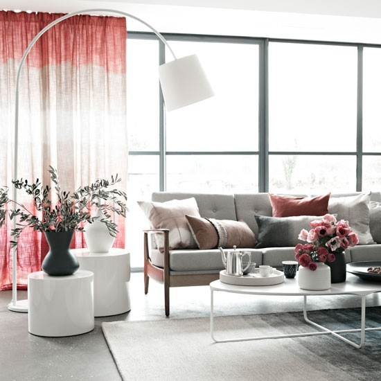 Grey living room with statement arc lamp and blush pink ...