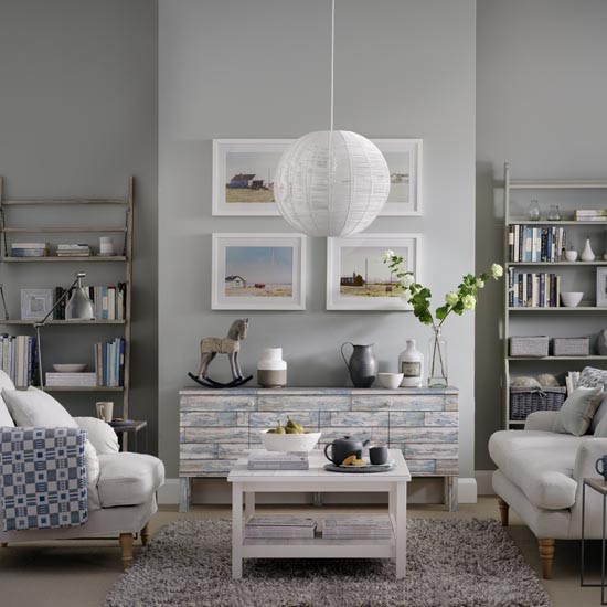 Grey living room with weathered wood furniture and coastal ...